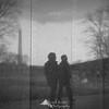 Vietnam Memorial Wall reflecting visitors and the Washington Monument - Washington, DC.