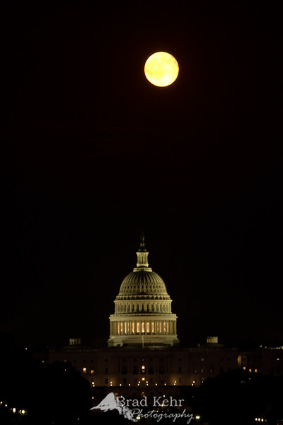 A full moon rising over the United States Capitol Building.<br /> <br /> You will probably be seeing a number of photos from Washington, D.C., posted by me over the next couple days. It is a photogenic city.