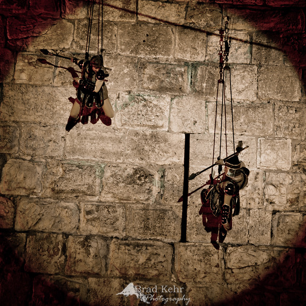 Aerial artists perform on the wall of Jerusalem during a Midieval Festival.