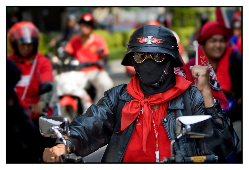 "Sat 20 March - Reds marching  Today the Reds made a city tour, meaning they drove around Bangkok to demonstrate against the sitting government. When i saw that they would pass pretty close to our home, i decided to take the bike and get close for some pictures. Actually ended up driving with them for a few km, taking pictures.. great fun. Great atmosphere and great people !!  I will post a gallery with pictures from that ride in a couple of days, meanwhile i give you the ""Red Darth Vader"""