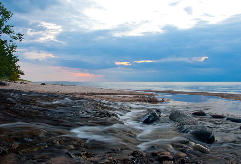 An evening storm approaches the mouth of the Hurricane River in the Pictured Rocks National Lakeshore.