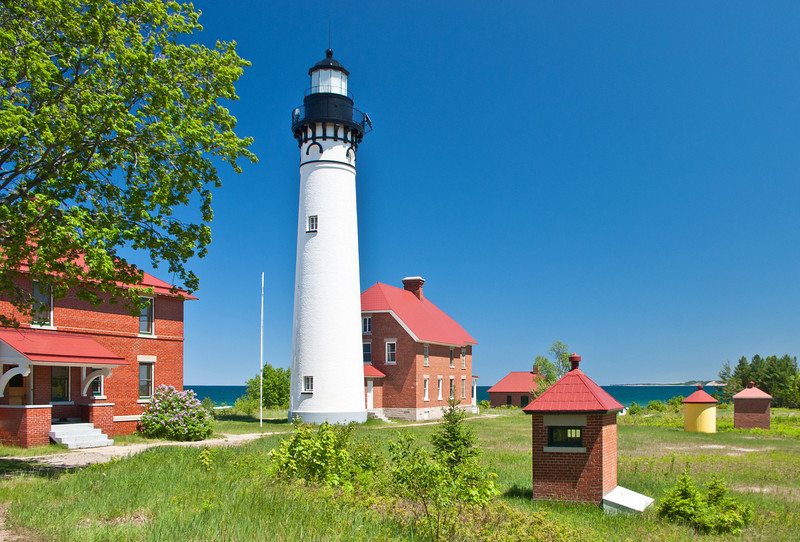 High above Lake Superior, Au Sable Lighthouse overlooks Grand Sable Banks in the Pictured Rocks National Lakeshore.