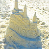 "Charles E. Chumley's sandcastle message: ""Choose Happy.''"