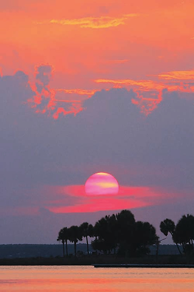 """It is no wonder Cathy Deal of Innerarity """"never gets tired of our local sunsets.'' Cathy took this picture looking towards Perdido Bay from Innerarity Point"""