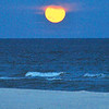 """After the sun goes down, the sky can just radiate with more color,'' writes Cathy Deal of Innerarity. Cathy also shares a full moon coming up over Johnson Beach."