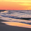 """""""Sunrise was coming up over Pensacola Beach from my viewpoint on Johnson Beach. Trees in the background are at  Ft. Pickens & the buildings are Pensacola Beach condos. They look like they're floating in the Gulf,'' writes Cathy Deal of Innerarity Point."""
