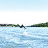 Christian Blake captured this dolphin mid jump! Taken at the mouth of the canal with Sailboat Bay condos in the background.