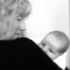 November 26 2009 - I did not take this picture, but I helped to process the photograph at Thanksgiving breakfast. Meet Oskar and his grandmother bonnie. Oskar was born in London just about a month ago. Converted to B and W, sharpened, add contrast, and lightened (not in that order).  I like the shot - just wish I took it.