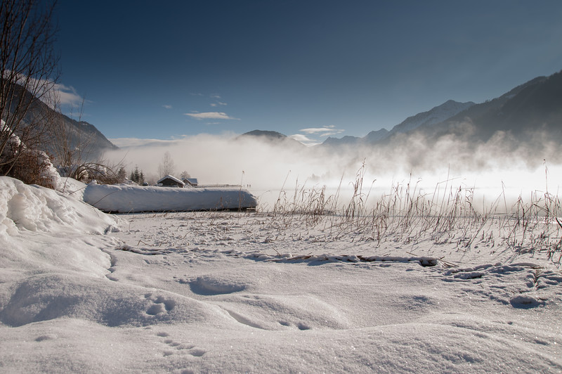 Winter fog over the frozen lake