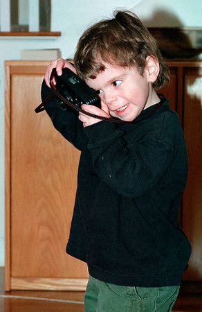Feb. 5, 2001<br /> Wayland, MA<br /> <br /> Eytan with Anne's camera.  Finally has a camera while Daddy takes pictures.  Spent days carrying the camera around (sorry, no film) taking pictures.
