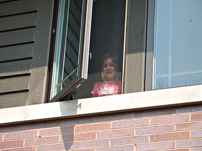 Julia greets us from  her window