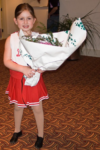 Julia = pleased with her bouquet