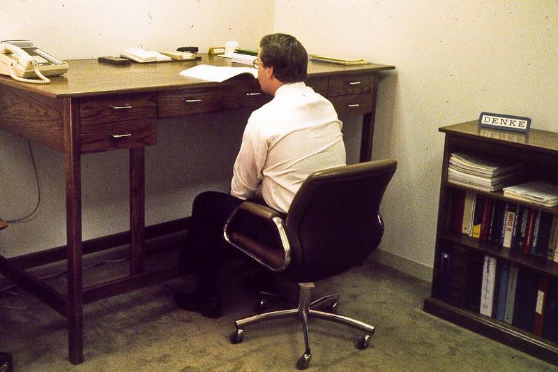 at big desk