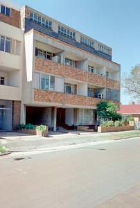 1965 - Yeoville, Johannesburg - Our first apartment After we married we moved into a one bedroom apartment in this bulding in Yeoville. Our unit was at the back, with no balcony. We were very happy - we had wall to wall floors, and a bed. This photo was taken long after we had moved. At that time, I only shot black and white film. I will scan the negatives when I find them. Lisa was born here.