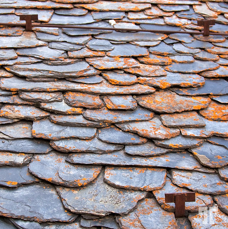 Rock scales roof