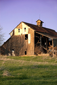 This barn has seen it's better days and a lot of history. The shinny metal towards the peak caught my eye as an interesting focal point and then allows your eye to move to the other ares.