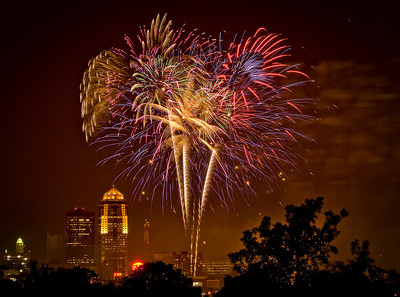 A great burst of fireworks from the State of Iowa Capitol lawn during the Yankee Doodle Pops. The brown haze was created by the smoke from firing the canons during the 1812 Overture played by the Des Moines Symphony.