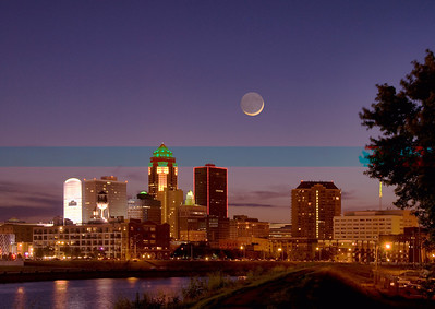 This Des Moines Iowa skyline photo was taken along the Des Moines River southeast of downtown. It was taken about 25 minutes after sundown so the moon could be more predominate in the evening sky.