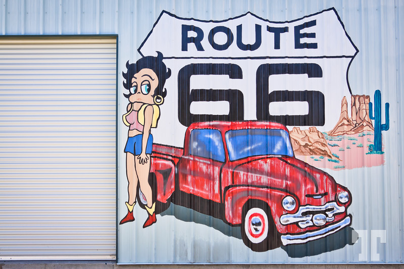 Route 66 sign and mural on a garage wall in Needles, California