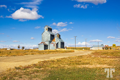 Old grain elevator by the railway in Cottonwood, South Dakota