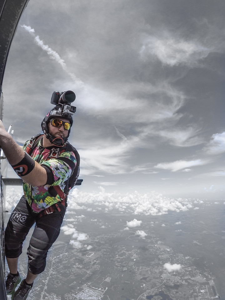 Curt Vogelsang hangs off the Twin Otter