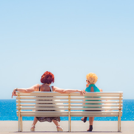 Two Ladies on a White Bench