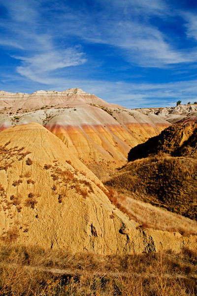 This is one of the colorful scenes from the Badlands.  The formation is called the Yellow Mounds.  The various hues came from the build up of different kinds of sediment over the geologic history of the Badlands.
