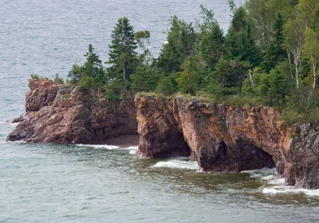 Here's another photo taken on our trip to the North Shore.  It shows the rocky shoreline of Lake Superior and was taken at Tettegouche State Park.  Notice how the wave action has carved out caves underneath the overhanging ledge.