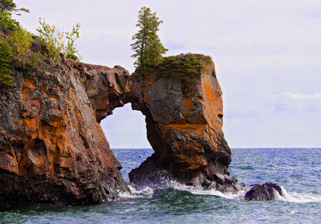 Tettegouche State Park is near the place where we stayed on our North Shore trip.  We were due to have a full moon on one of the days we were there.  Paul Sundberg, one of my photographer friends, told me about this rock arch at Tettegouche Park.  He said if I was one the beach by the arch, the full moon would rise near it.  I went there during the day so I would be sure of how to find it.  Here is what it looks like during the day.