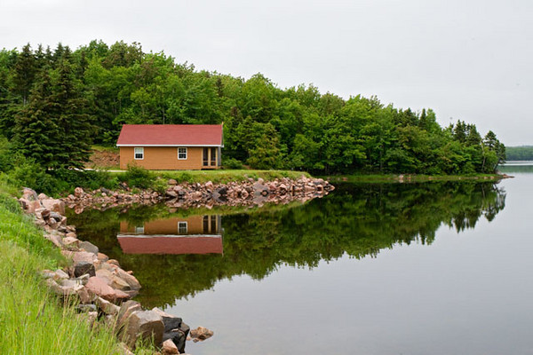 I don't take many scenery shots but I couldn't pass this one up. The water in this bay along Cape Breton Island was so calm that it gave a mirror-like reflection of the cabin.