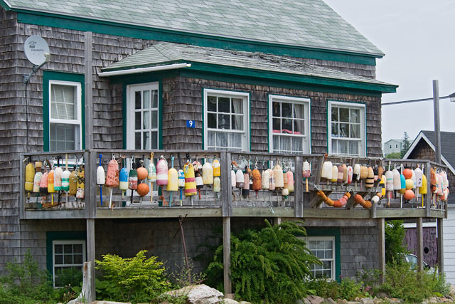 Diana and I came across this house as we drove around town and I just had to take a photo of it.  We later learned that one of our Elderhostel instructors lives here.  She has been collecting these floats, used to mark the location of lobster traps, when she found them floating loose in the open ocean.  They make for a very colorful house decoration.