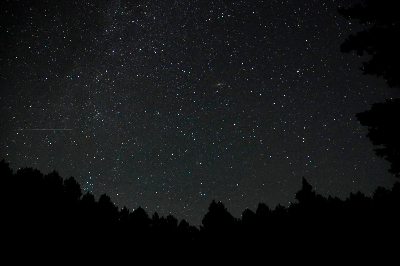 Here's a different part of the sky showing the Milky Way.  There's a horizontal streak of light on the left side of the picture.  I think it was a satellite moving across the sky.
