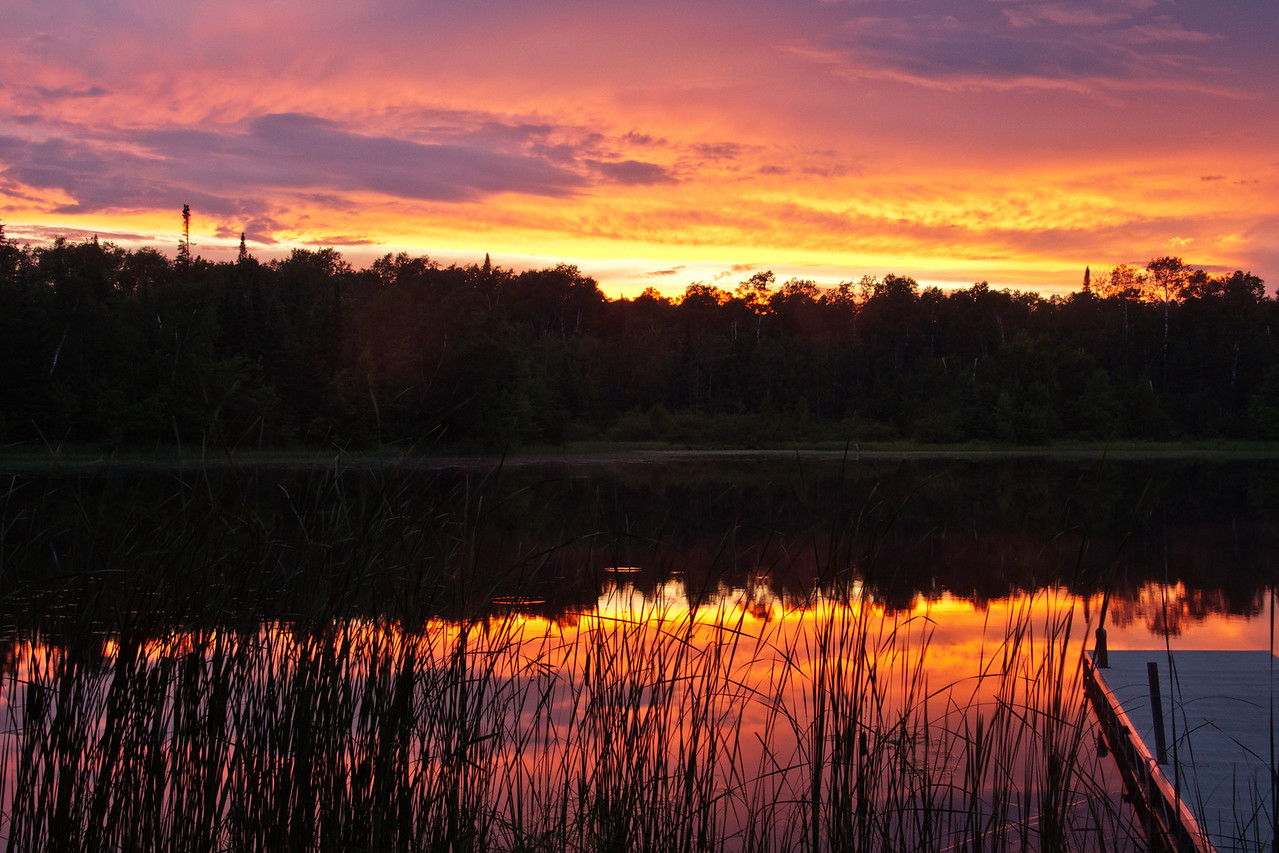Here's a recent sunset photo taken from the shore of our lake.