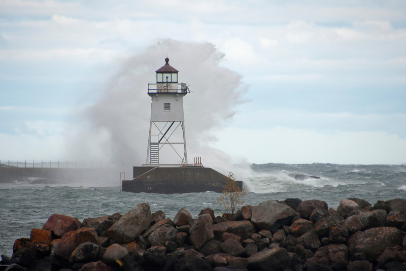 Last week I attended a photography workshop at the North House Folk School in Grand Marais, MN.  The weather on the first day of the workshop was cold and windy.  It gave us a chance to see the power of the waves on Lake Superior.  Waves were crashing on the rocks and this one went so high it was above the top of the lighthouse in the Grand Marais harbor.