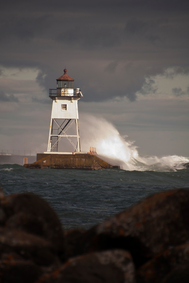 The day was dark and cloudy but we did have about 30 seconds when a shaft of sunlight broke through the clouds and illuminated the lighthouse.  If I had been looking away during those 30 seconds, I would have missed this dramatic shot.
