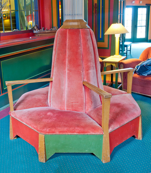This unique chair sits in the waiting area of the dining room.  It's octagonal in shape to accommodate 8 people.  It would be cozy seating for four couples.