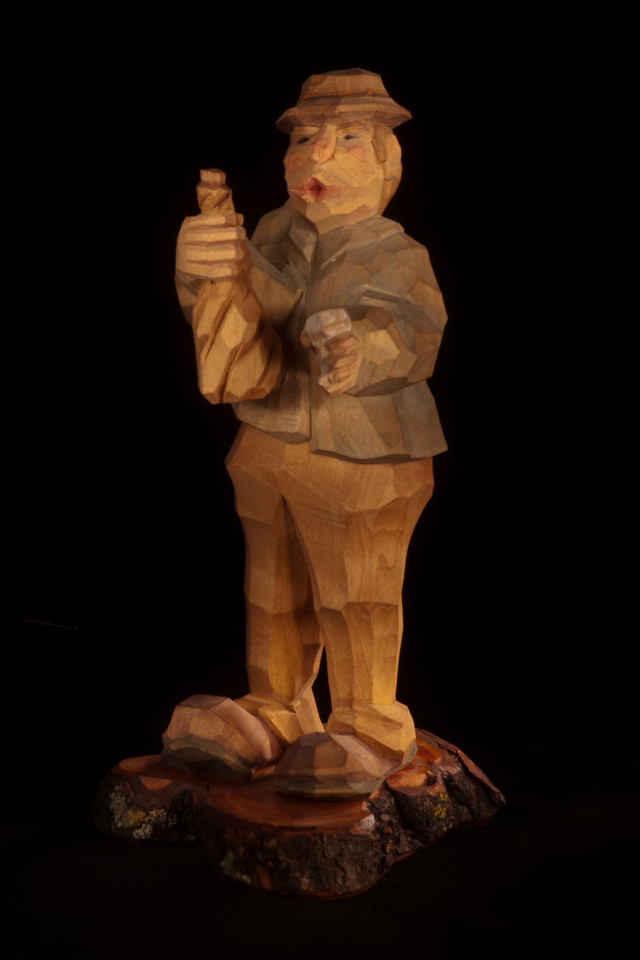 We then switched objects with another class member.  This carved figure was a little trickier because of all the angled knife cuts.  For example, I found that I needed to hold my flashlight low and shine it under his hat to make sure his face was fully lighted.