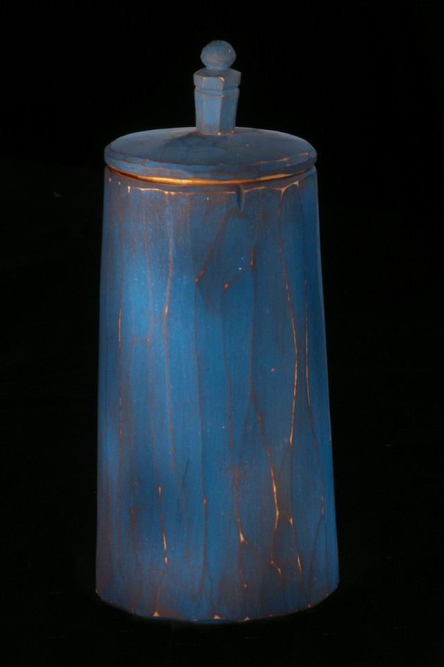 """One of the new techniques I learned at the North House Folk School photography workshop was """"light painting.""""  Each of the workshop participants picked a small object and positioned it on a black cloth background.  Mine was this blue wooden container.  We mounted our cameras on tripods and set them for a 30-second exposure.  After framing the object and manually focusing on it, the lights were turned out and we were in total darkness.  We started our 30-second exposure and each of us used a small flashlight to """"paint"""" our object, moving around to light all sides of it.  The result (after several tries) was a softly lighted, almost glowing photo.  I was amazed that a small flashlight could produce such a stunning picture."""