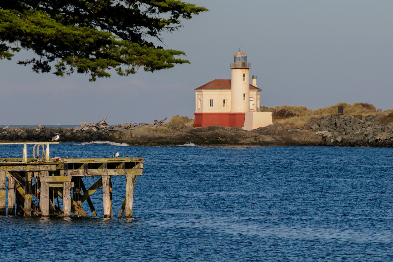 This lighthouse is located on the North Jetty of the Coquille River in Bandon, Oregon.  It was put into service in 1896.  In 1939, the Coast Guard installed an automated light on the South Jetty and the lighthouse was abandoned.  After being neglected for many years, a restoration of the lighthouse was begun in 1976 by the Oregon State Parks and the Army Corps of Engineers.  It is now open to the public and even gets decorated with festive lights in December.