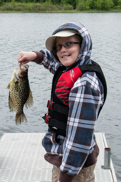 Last week, Dylan, our 12-year-old grandson, spent a few days with us at our lake home.  He is really interested in fishing, so he and Grandpa were out on the lake a lot.  We don't catch very many Crappies at our lake, so Dylan was proud of this nice specimen that he landed.