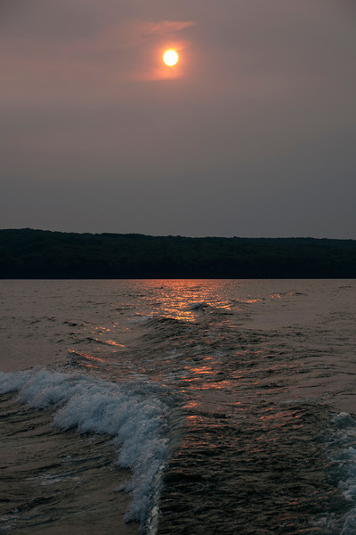There was a lot of haze in the sky the day of the boat trip, perhaps from fires burning in Canada or in the western U.S.  The boat trip ended around sunset so the hazy sky turned the sun into a brilliant orange ball.  I liked the way it reflected off the wake of the boat.