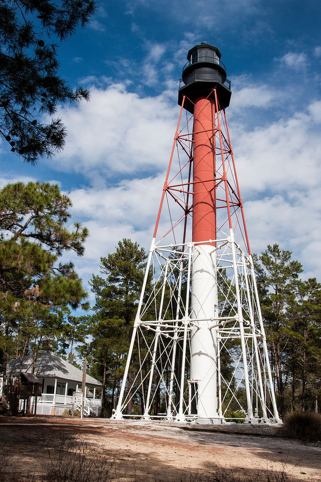 This is the Crooked River Lighthouse, located near Carrabelle Beach, Florida.  It was built in 1895 to replace a lighthouse on Dog Island.  That lighthouse was destroyed during a hurricane in 1873.  The current lighthouse was decommissioned in 1995.  The Carrabelle Lighthouse Association was formed to preserve and restore it.  It's open to the public; you can climb to the top, via the stairs in the central column, on Saturdays and Sundays for a small fee.