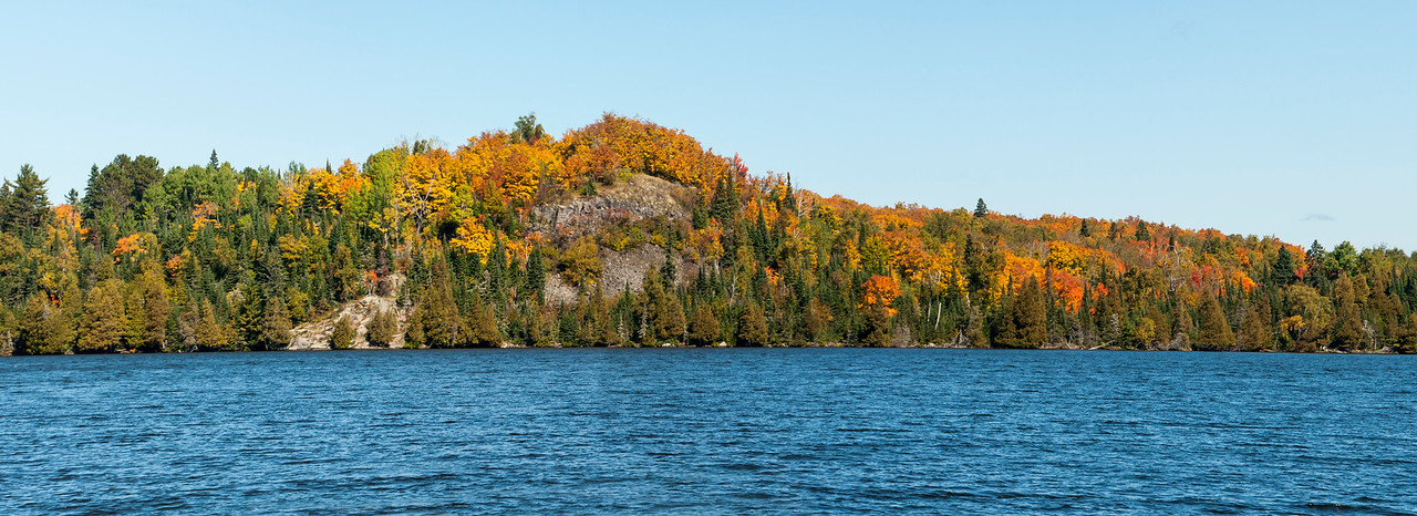 "Fall colors are at their best when you get a wide-angle perspective.  This is a rocky hillside on Caribou Lake in Cook County.  I took three photos and stitched them together in Photoshop to get this panoramic view.  (Click on the photo to see a larger version of it.  Then click on the word ""Close"" in the upper right corner to return to the original size.)"