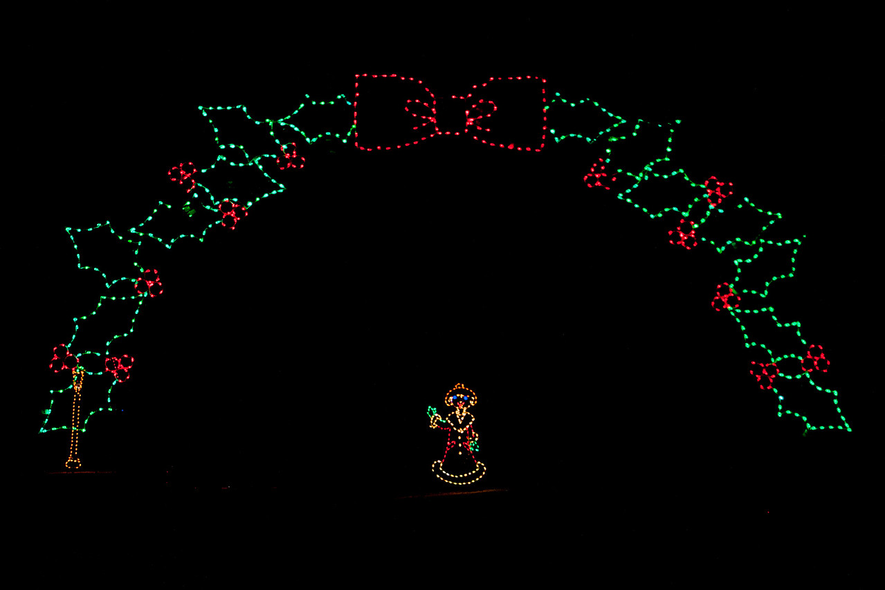 A holiday light display was set up again this year at Phalen Park in St. Paul, MN.  More than 60 themed displays were created by the National Electrical Contractors Association.  This was the entrance to the drive-through route.  To give some perspective, cars could drive into the area on either side of the figure in the middle.