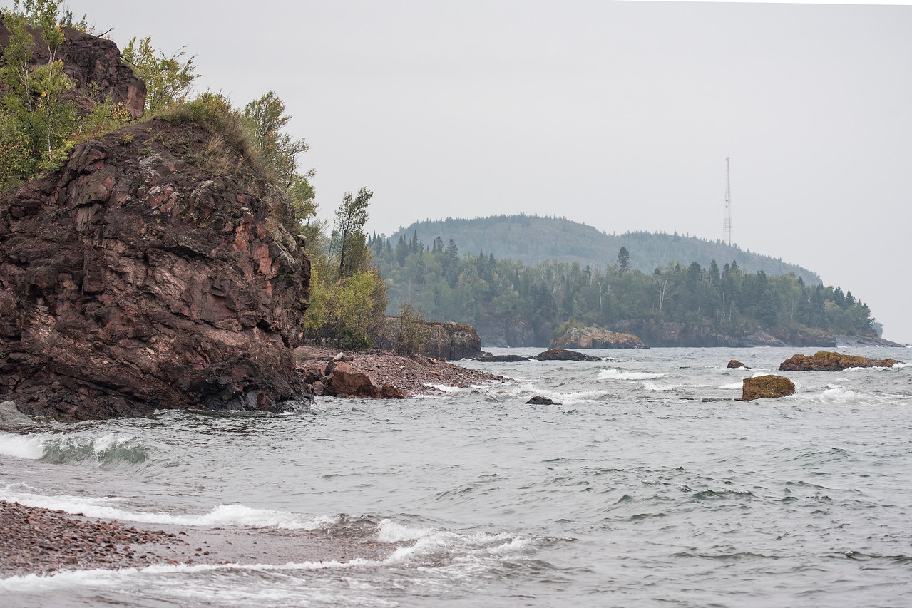 We made our first visit to Black Beach, near Silver Bay.  There are three separate beach areas with black sand and very scenic views.  This photo was taken looking up the shore.  Palisade Head (with the cell tower) is in the background.