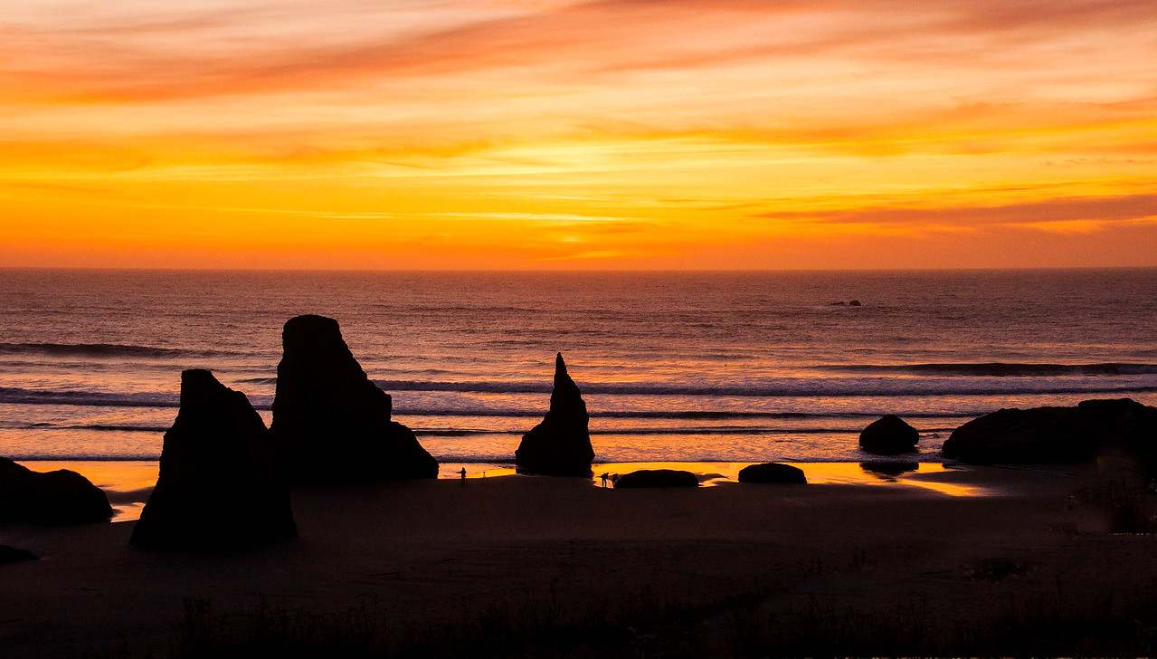 This is the view from the condo unit we rented.  We had several spectacular sunsets looking out over the Pacific Ocean.  Those rocks along the shore are called sea stacks and they are huge!  There are two people along the shore, about in the middle from left to right, to give some perspective on the size of the rocks.