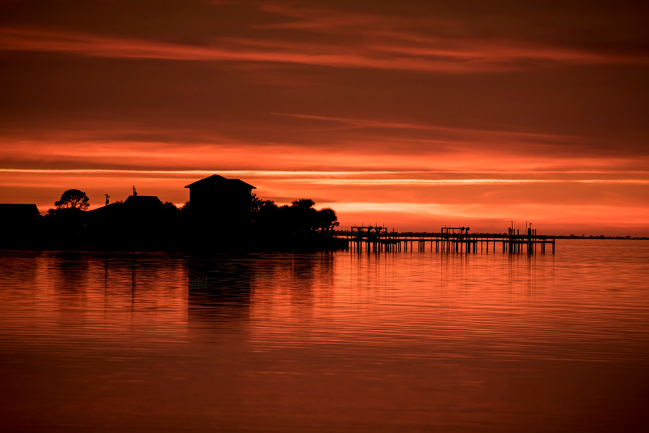 There is a 4-mile causeway from Eastpoint to St. George island.  Where the causeway meets the island is a great place to take a sunset photo.  The buildings in this photo are on the island.