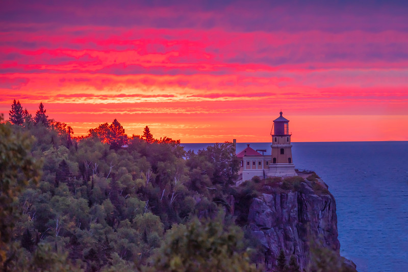 We were there at a time when the sun rises right near Split Rock Lighthouse.  I got up early one morning and hit the jackpot!  There were enough clouds to produce a spectacular sunrise right behind the lighthouse.