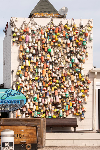 This huge collection of buoys was hanging on the side of a building in Apalachicola.