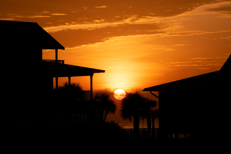 Here's a photo of a beautiful sunrise looking out over the Gulf of Mexico.